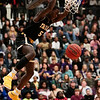 Nadav Soroker/Times-Georgian<br /> <br /> Carrollton Trojan Melvin Edwards hangs off the basket after dunking on the Villa Rica Wildcats at the Villa Rica High School gym on Tuesday, January 8, 2019.
