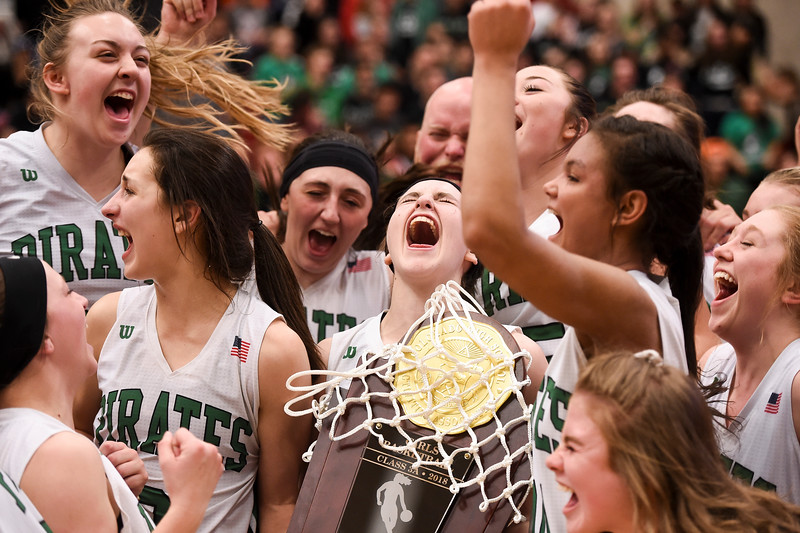 St. Mary's players cheer with the state champions trophy at the University of Denver - Hamilton Gym on Saturday, March 10, 2018. St. Mary's defeated Colorado Springs Christian School 44-38 to become the state 3A Girls' Basketball Champions.<br /> <br /> (Nadav Soroker, The Gazette)