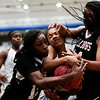 Nadav Soroker/Times-Georgian<br /> <br /> A Carrollton Lady Trojan gets hammered in between two Tri-Cities Girls in the Lady Trojans' 69-39 victory at the Carrollton High School Invitational Tournament at the Coliseum on Thursday, December 20, 2018.