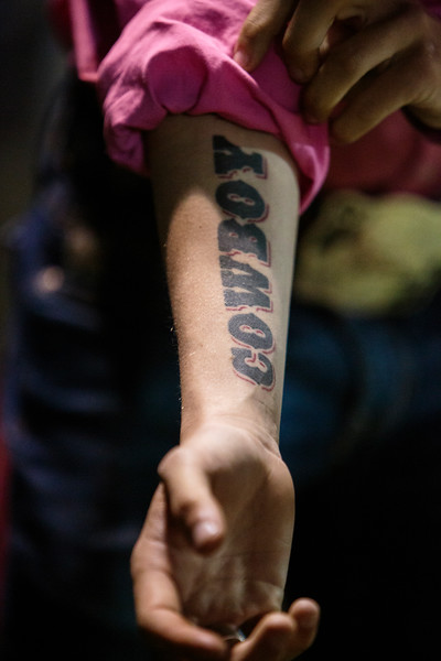 Nadav Soroker/Times-Georgian<br /> <br /> J.R. Henson rolls up his sleeve, revealing his tattoo, as he prepares for his shot at the bull ride at the Bremen Pro Rodeo in Bremen, on Friday, April 12, 2019. Henson says the tattoo is the last thing he sees before the chute opens.