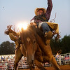 Nadav Soroker/Times-Georgian<br /> <br /> Eddie Parlier throws his hand back while keeping his seat into first place in the Saddle Bronc ride with a score of 81on the second night of the Don-Rich Ford Villa Rica Frontier Days Rodeo, on Saturday, August 25, 2018.