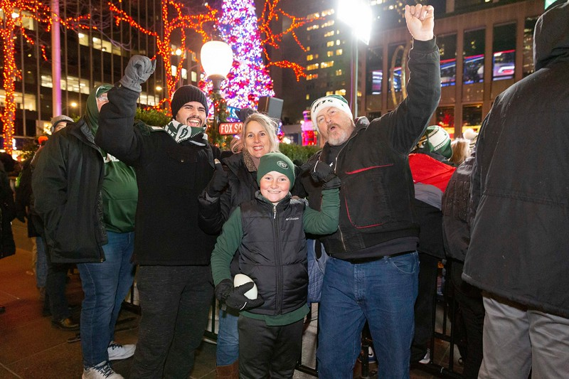 NEW YORK - December 12, 2019: for NEWS. (from right to left) Jets Fans Jacob Sivigila, 22, Marci Wild, 48, Adam Wild, 10, Bob Wild, 57, of Orlando Florida, who were also at MetLife Stadium for the Jets - Miami Dolphins game and rooted for the Jets over their native Floridian team, outside the NFL at FOX set up at 1211 Avenue of the Americas. (Photo by Taidgh Barron/NY Post)