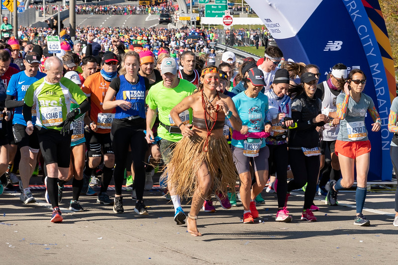 STATEN ISLAND, NY - November 3, 2019: for NEWS. Brynda Grube, 41, of Manhattan starting the New York City Marathon barefoot in a hula costume. Ms. Grube went on to complete the marathon in 5 hours and 53 minutes. (Photo by Taidgh Barron/NY Post)