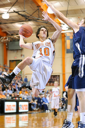 Lenoir City's point guard Dillon Powers drives to the basket in their District Tournament game against Anderson County Friday night.  Photo by Bryan Lynn.