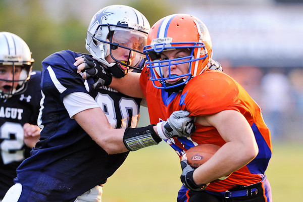 The North Panther's tight end Matt Scott tries to break free from the grasp of Farragut's Chris Harding in Thursday night's game.  The Panthers suffered only their second loss of the season.  Photo by Bryan Lynn.