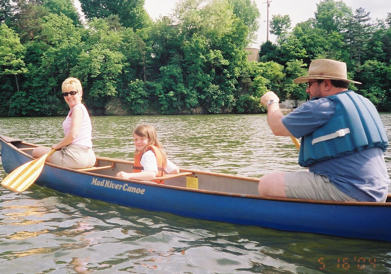 8.  Carol and Jeff Hewitt and their granddaughter hit the lake in their <br />       Canoe.  5-16-04