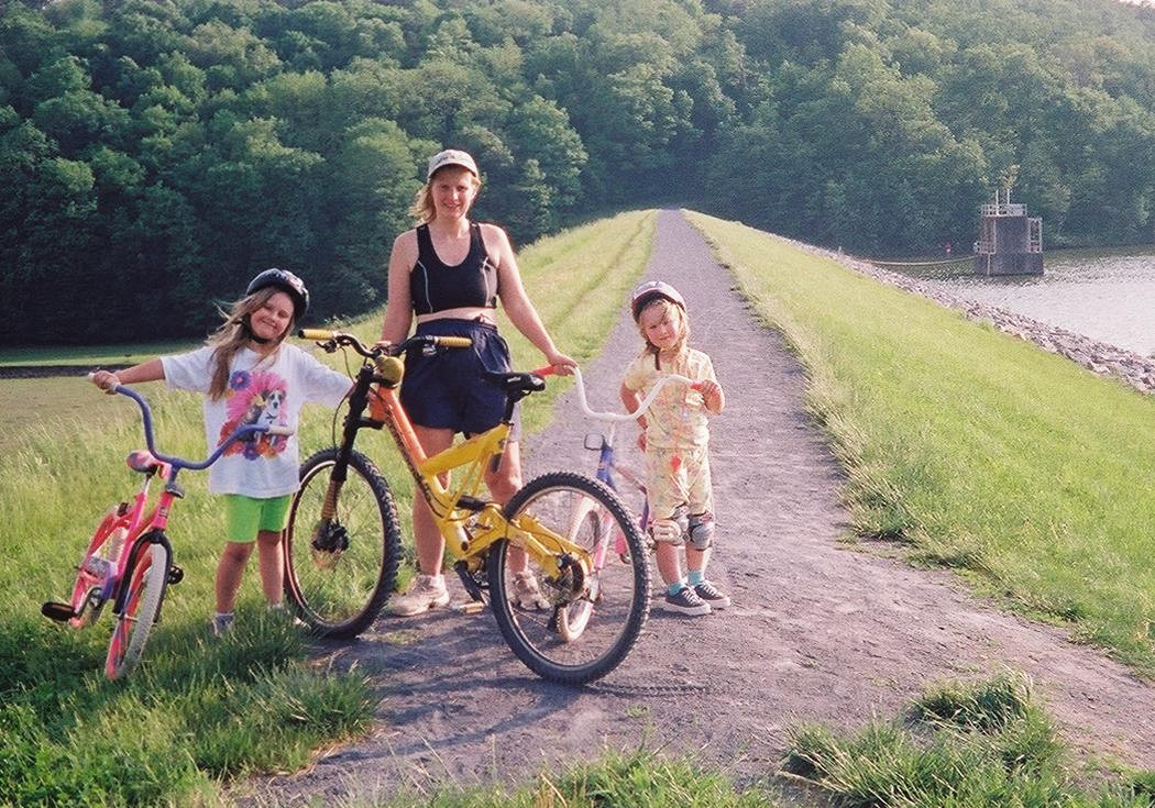 2.  Kristina, Patty & Katie riding bikes around the dam at Shawnee.    <br />        5-16-04