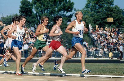 Tracy Smith running against Steve Prefontaine, early 1970s.