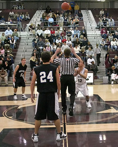 Referee tosses the ball up for the opening tipoff