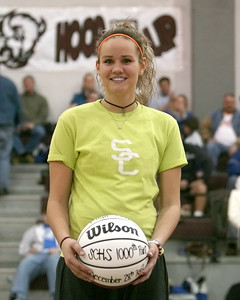 """Lady Bison Ellyn Unger is """"all smiles"""" as she accepts a ceremonial basketball for achieving her 1,000th career point - Ellyn achieved this milestone during the 2007 Nera White Christmas Tournament."""