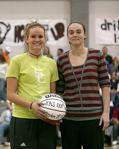 Lady Bison Head Basketball Coach Kendra Jackson congratulates Ellyn Unger on achieving her 1,000th career point - Ellyn achieved this milestone during the 2007 Nera White Christmas Tournament (2).