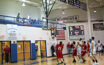 Quinton West takes the ball and slams home a dunk on the opening play of the 2007 Nera White Men's Championship game (wide crop)