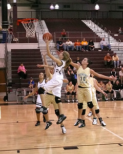 Heather Hughes drives for a layup