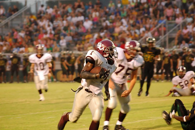 Toney scampers toward the end zone