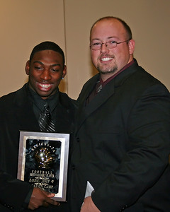 Randall Toney receives the Region 4 - 3A Most Valuable Player award from Coach Walker
