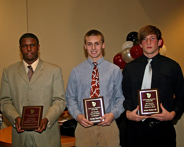 Ben Roberts receives the All County 2nd Team Defensive Lineman award, Hunter Tope receives the All County 2nd Team Linebacker award and James Button receives the All County 2nd Team Defensive Back award