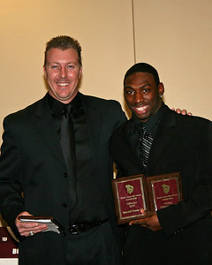 Randall Toney receives the Offensive MVP and Offensive Back awards from Coach Schoenbachler
