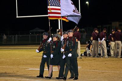 Junior ROTC Honor Guard displays the colors
