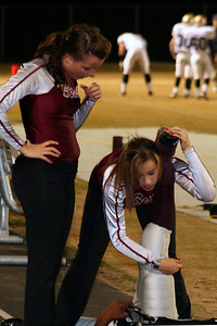 Senior Team Manager Sable Royal stretches out Bailey while Stephanie White observes