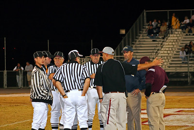 AD Hayes, Coach Holly, Sycamore Coach and referee team discuss the game