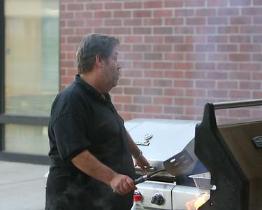 Bison Quarterback Club President Don Lane does burger duty