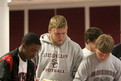 Bison Ron Lark, Austin Piercey and Justin Holman pile up their plates