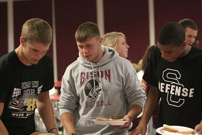 Seniors Jacob Barker, Chuck Lilly and David Cartwright select their fare