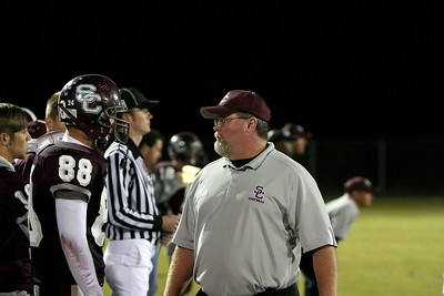 Coach Anderson talks with Jacob Barker