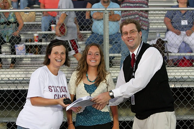Daphne Coomer, Christina Brimm and Art Crook prepare for the halftime ceremonies