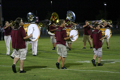 Drummers marching past the brass section