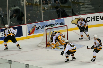 Bruin goalie goes to block the puck