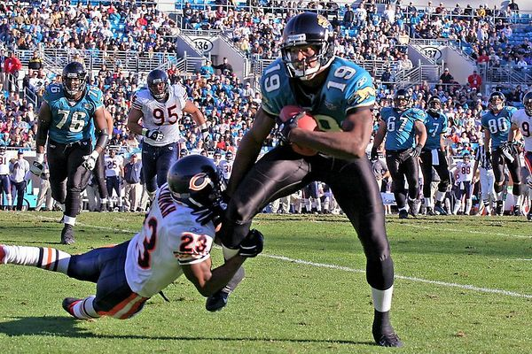 Jaguars receiver Earnest Wilford is tackled midfield after catching a pass thrown by Byron Leftwich for a gain of 9 yards.