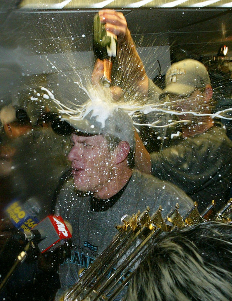 Jeff Conine celebrate the winning of the World Series 2003