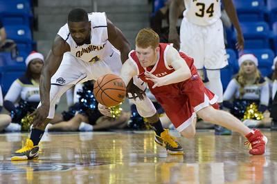 Boston University's Kyle Foreman (25) and Quinnipiac's Govanni McLean (4) dive for a loose ball Sunday at the TD Bank Sports Arena in Hamden Dec. 13, 2015 | Justin Weekes / For the Record-Journal