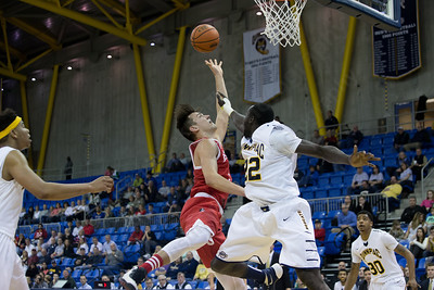 Boston University's Nick Havener (1) in the lane with Quinnipiac's Samuel Dingba (22) Sunday at the TD Bank Sports Arena in Hamden Dec. 13, 2015 | Justin Weekes / For the Record-Journal