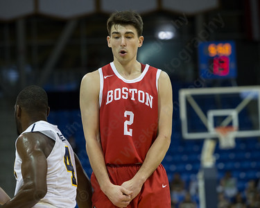 Boston University's John Papale sets a screen on Quinnipiac's Giovanni McLean Sunday at the TD Bank Sports Arena in Hamden Dec. 13, 2015 | Justin Weekes / For the Record-Journal