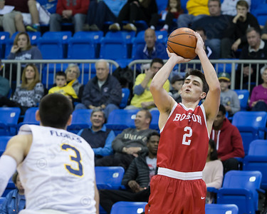 Boston University's John Papale hits a three point shot from the corner Sunday at the TD Bank Sports Arena in Hamden Dec. 13, 2015 | Justin Weekes / For the Record-Journal