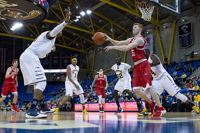 Boston University's Kyle Foreman (25) with a no look pass to the point Sunday at the TD Bank Sports Arena in Hamden Dec. 13, 2015 | Justin Weekes / For the Record-Journal