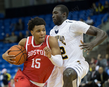 Boston University's Cheddi Mosely (15) drives past Quinnipiac's Samuel Dingba (22) Sunday at the TD Bank Sports Arena in Hamden Dec. 13, 2015 | Justin Weekes / For the Record-Journal