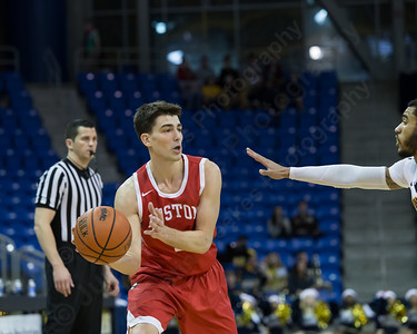 Boston University's John Papale looks to pass as Quinnipiac's Ayron Hutton defends Sunday at the TD Bank Sports Arena in Hamden Dec. 13, 2015 | Justin Weekes / For the Record-Journal