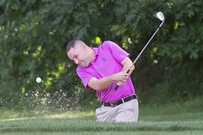 Dan O'Quendo plays out of a green side bunker on 18 Saturday during the Meriden Open Golf Tournament at Hunter Golf Club in Meriden Aug. 19, 2017 | Justin Weekes / For the Record-Journal