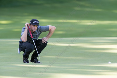 Keegan Bradley eyes the line for a put on fifteen Thursday during first round play at the Travelers Championship in Cromwell  Jun. 25, 2015 | Justin Weekes / For the Record-Journal