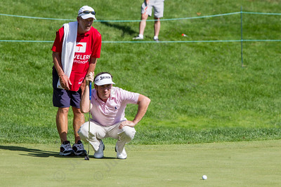 Gonzalo Fdez-Castano and caddy take a look at the green before putting on 18 Wednesday during the Travelers Championship Pro-Am at TPC River Highland in Cromwell Jun. 24, 2015 | Justin Weekes / For the Record-Journal