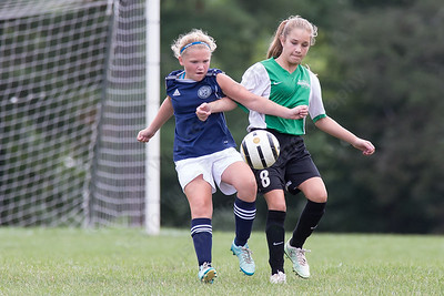 Meriden's Elli Cloutier and Wallingford's Shelby Johnson (8) challenge for a loose ball Sunday during the TWIST at Choate Rose Mary Hall in Wallingford Aug. 21, 2016 | Justin Weekes / For the Record-Journal