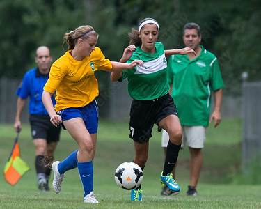 WYSL United's Yesenia Dominguez (7) and Brazil CT's Kelsey Burr vie for a loose ball Saturday during the Wallingford Invitational Soccer Tournament at Choate Rosemary Hall in Wallingford Aug. 20, 2016 | Justin Weekes / For the Record-Journal
