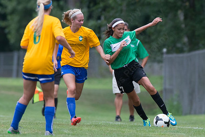 WYSL United's Yesenia Dominguez (7) keeps the ball in play as Brazil CT's Daniel Paparian challenges Saturday during the Wallingford Invitational Soccer Tournament at Choate Rosemary Hall in Wallingford Aug. 20, 2016 | Justin Weekes / For the Record-Journal