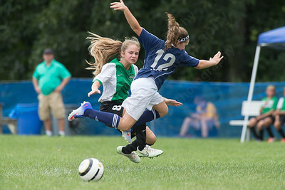 Meriden's Lily Marcuss (12) gets tripped up by Wallingford's Shelby Johnson Sunday during the TWIST at Choate Rose Mary Hall in Wallingford Aug. 21, 2016 | Justin Weekes / For the Record-Journal