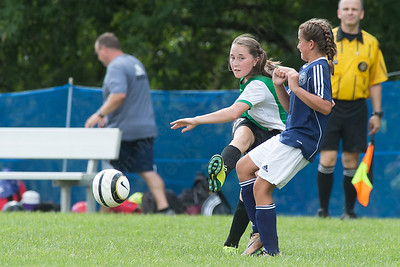 Wallingford's Emma Jacobs sends a pass as Meriden's Sophie Whittle defends Sunday during the TWIST at Choate Rose Mary Hall in Wallingford Aug. 21, 2016   Justin Weekes / For the Record-Journal