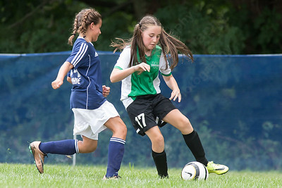 Wallingford's Emma Jacobs (17) tries to get past Meriden's Sophie Whittle Sunday during the TWIST at Choate Rose Mary Hall in Wallingford Aug. 21, 2016 | Justin Weekes / For the Record-Journal