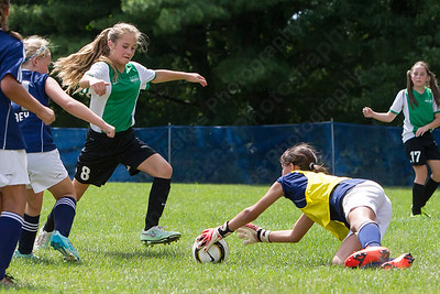 Meriden's keeper Briana Lacourse comes out to stop a shot from Wallingford's Shelby Johnson (8) Sunday during the TWIST at Choate Rose Mary Hall in Wallingford Aug. 21, 2016   Justin Weekes / For the Record-Journal